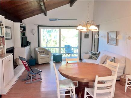 Wellfleet Cape Cod vacation rental - Open concept living/dining area with slider to deck.