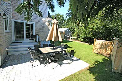 Dennis, North Side Cape Cod vacation rental - Backyard patio with an awesome hammock in the background