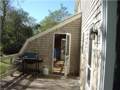 North Eastham Cape Cod vacation rental - Deck off kitchen with gas grill, open to green house