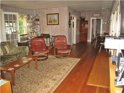 East Falmouth Cape Cod vacation rental - Living room, dining behind on R, porch to R, water view