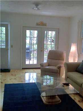 Harwich Port Cape Cod vacation rental - Family room with two recliners & French doors to the outside