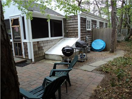 Dennisport Cape Cod vacation rental - Patio with gas grill - outdoor shower out back.