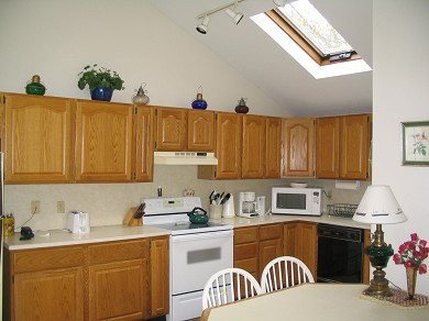 West Yarmouth Cape Cod vacation rental - Modern Kitchen w skylights, dine in or out on the deck