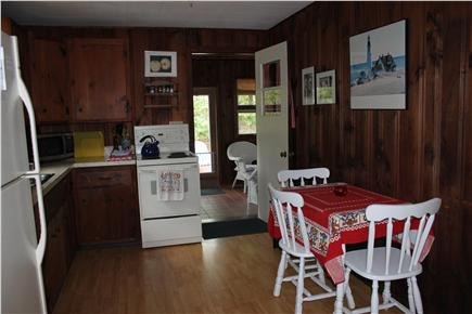 North Eastham Cape Cod vacation rental - Kitchen to left of front entrance, opening onto porch.
