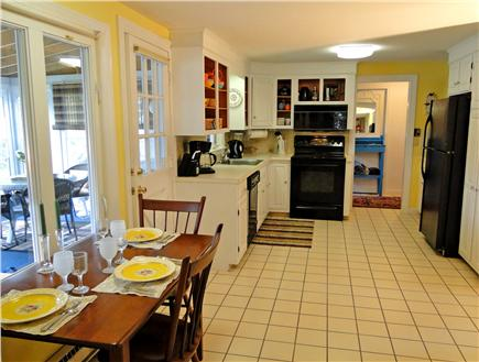 Falmouth Cape Cod vacation rental - Tiled kitchen with dining area, facing water