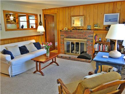 South Dennis Cape Cod vacation rental - Spacious living room with fireplace, large window, satellite TV