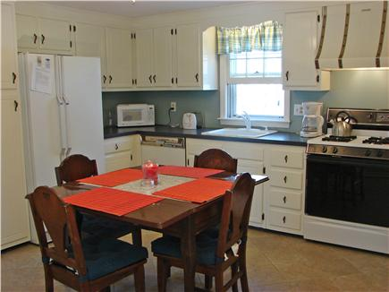 South Yarmouth Cape Cod vacation rental - Bright kitchen with sitting area, adjacent to sun porch