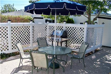 Dennisport Cape Cod vacation rental - The gas grill barbecue area is centrally located by the pool.