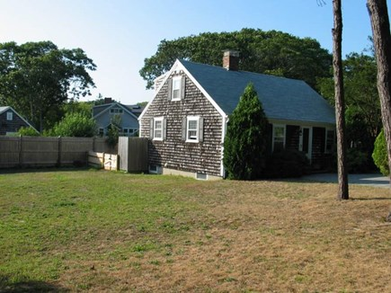 Harwichport Cape Cod vacation rental - Open yard with privacy fence.