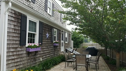 Harwichport Cape Cod vacation rental - Travertine patio off Kitchen.