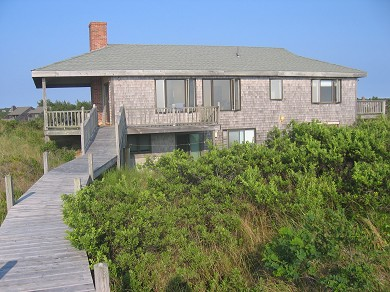 Truro Cape Cod vacation rental - House from the deck at the edge of the dune (water behind you)