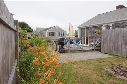 West Dennis Cape Cod vacation rental - Back yard with seating, grill and outdoor shower
