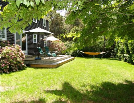 Chatham Cape Cod vacation rental - Outdoor dining on deck overlooking yard - with sun and shade