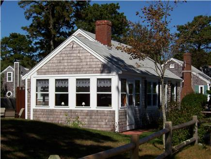 Dennis Port Cape Cod vacation rental - Sun room with slider out onto the private brick patio area
