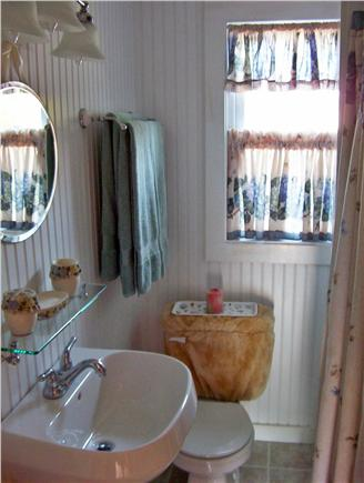 Dennis Port Cape Cod vacation rental - Bathroom with shower and laundry.
