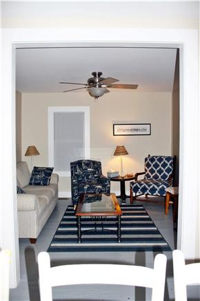 Brewster-North of 6A Cape Cod vacation rental - Living room with comfortable couch, two chairs & TV