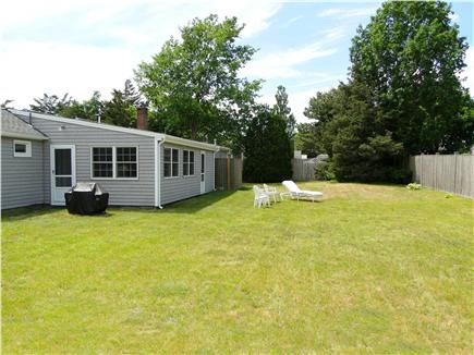 West Yarmouth crowell and seag Cape Cod vacation rental - Spacious backyard with grill, outdoor shower, lawn furniture