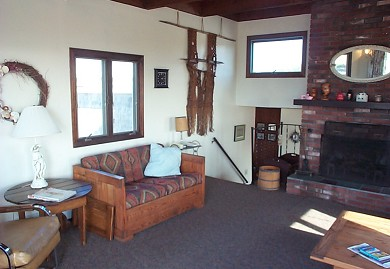 Fisher Beach, Truro, Cape Cod Cape Cod vacation rental - Living Room with fireplace and steps to Dining Area