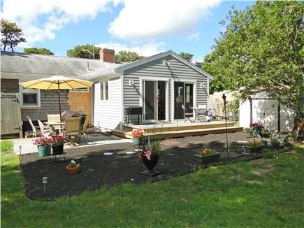 Chatham Cape Cod vacation rental - New expanded deck with tables, grill and lovely views of lawn