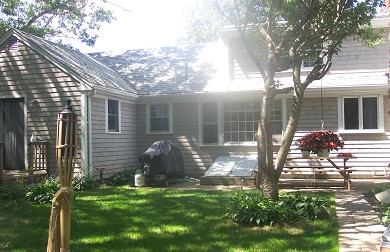 South Yarmouth Cape Cod vacation rental - Private backyard-picnic table, gas grill, firepit, outdoor shower