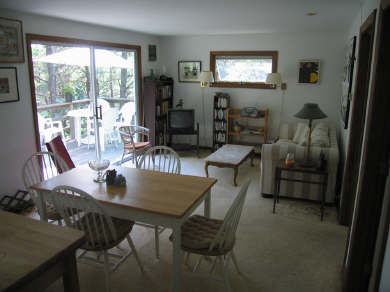Truro Cape Cod vacation rental - Living Room with sofa bed and sliding glass door, view to woods