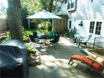 Dennis Cape Cod vacation rental - Back patio, gas grill, firepit, outdoor shower, shed