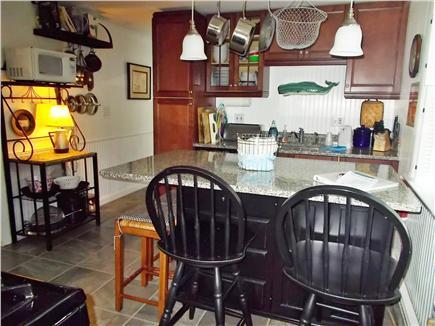 Dennis Cape Cod vacation rental - Kitchen seating at granite island, dishwasher, potfiller at stove