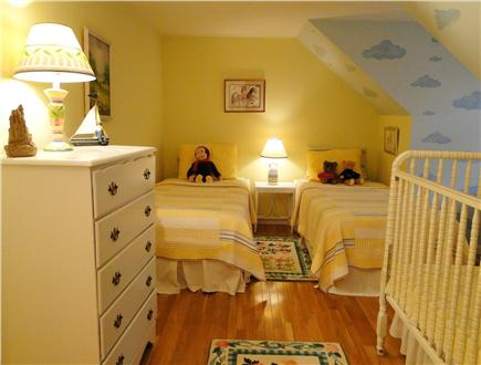 West Brewster/East Dennis Cape Cod vacation rental - Upstairs bedroom with two twins and a crib