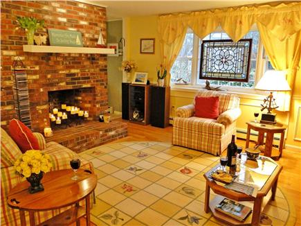 West Brewster/East Dennis Cape Cod vacation rental - Living room with fireplace