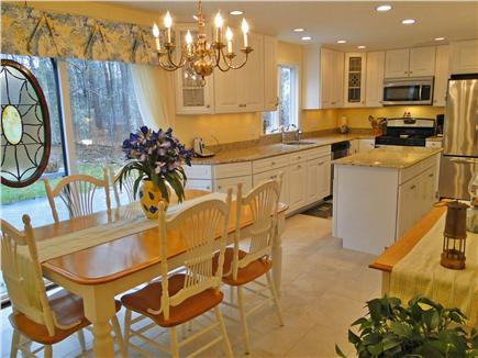 West Brewster/East Dennis Cape Cod vacation rental - Spacious dining area with slider to decks and back yard