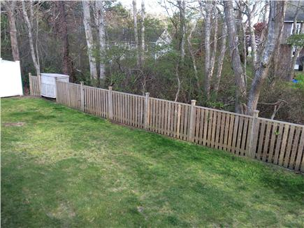 West Yarmouth Cape Cod vacation rental - Fenced backyard