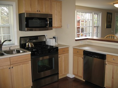 Downtown Chatham Cape Cod vacation rental - Kitchen with counter seating for 2 and updated appliances