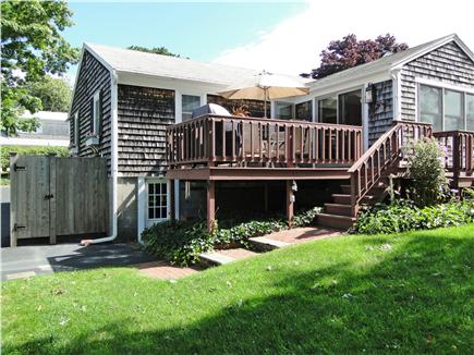 West Yarmouth Cape Cod vacation rental - Back yard, with gardens, and two seating areas
