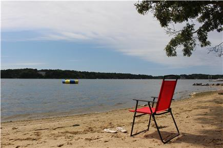 South Dennis Cape Cod vacation rental - Private beach on the pond, swing set and RAVE water trampoline
