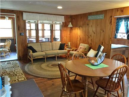 South Dennis Cape Cod vacation rental - Dining area and living room with entrance to enclosed porch