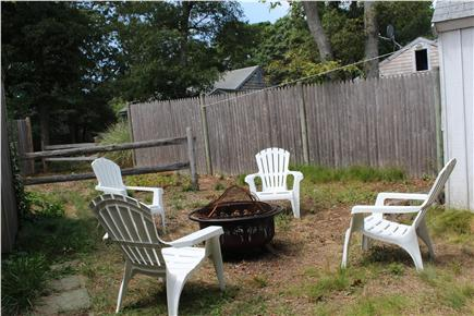 South Dennis Cape Cod vacation rental - Gas grill, fire pit, umbrella and chairs, and outdoor shower