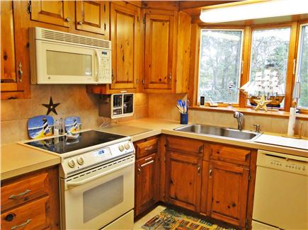 Chatham Cape Cod vacation rental - Kitchen area, ample china, utensils and storage, overlooking back
