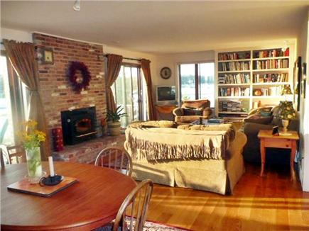 Mashpee, South Cape Beach Cape Cod vacation rental - Living room with fireplace- double sliders