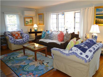 West Harwich Cape Cod vacation rental - Bright living room with bay window and fireplace