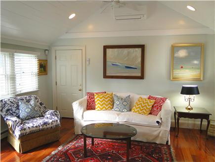 West Harwich Cape Cod vacation rental - Den area with TV and door to back patio