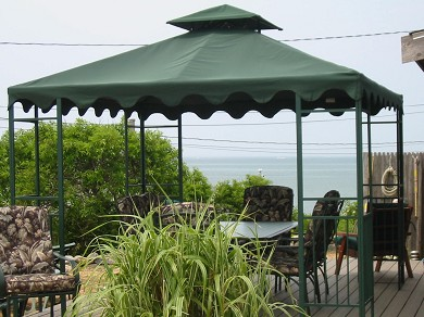 Eastham Cape Cod vacation rental - Back deck privacy & dining with a gorgeous view