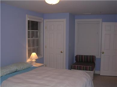 Mashpee, Popponesset Cape Cod vacation rental - Blue guest room with dual air chamber queen bed.