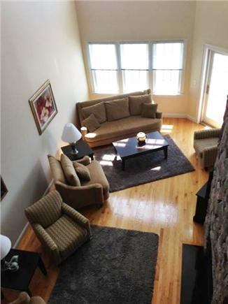 Falmouth Heights Cape Cod vacation rental - Spacious living areas with fireplaces and slider to deck.