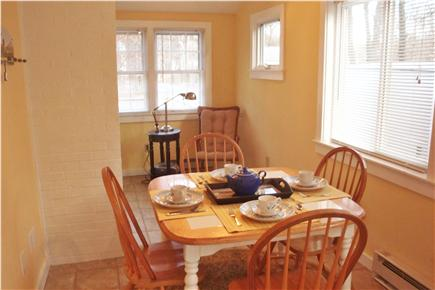 South Dennis Cape Cod vacation rental - Dining area with sliders to back deck & yard