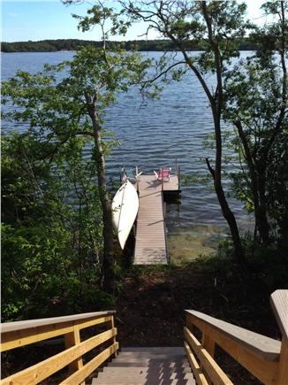 Brewster Cape Cod vacation rental - Stairs down to private dock with canoe