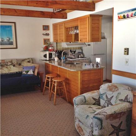 Chatham Cape Cod vacation rental - Living Area looking into kitchen with breakfast bar