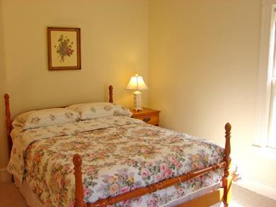 Dennis Cape Cod vacation rental - 3rd bedroom on main level. Upstairs loft has 4 more twins + 1 dbl
