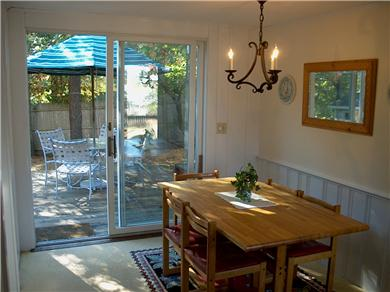 Chatham Cape Cod vacation rental - Dining area; table seats 8; deck  with grill and table/umbrella