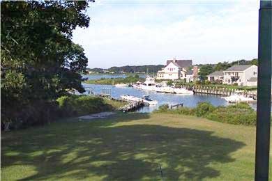East Falmouth Cape Cod vacation rental - View of back yard from the upper deck.