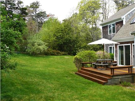 East Orleans Cape Cod vacation rental - Back deck and yard in May